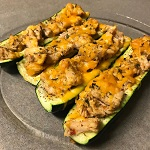 Lemon Harissa Chicken Stuffed Zucchini Boats